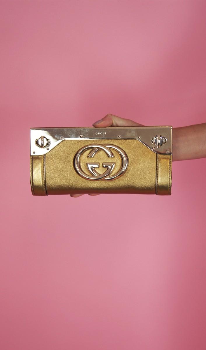 Clutch Gucci dourada